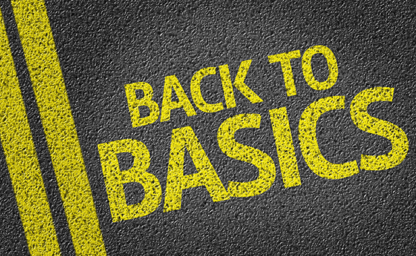 yellow text on road spelling 'Back to Basics'