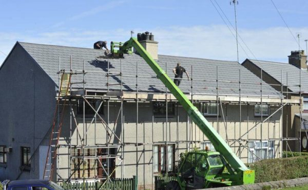 scaffold working at height on house